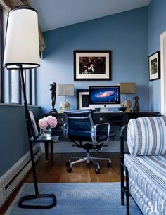 A blue and masculine study featuring a Jacques Adnet daybed upholstered in a Loro Piana linen | archdigest.com