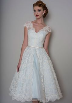 Lou Lou's Bella. Blue satin Bridal gown with Ivory lace overlay. Inspired by the1950's era, a stunning tea length wedding dress. Available at The Tailor's Cat, Cambridge 01223 366700