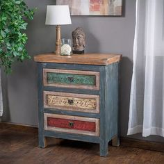 The Leo Cabinet is beautiful piece of craftsmanship that exudes all the charm of an antique piece. This cabinet offers users 3 spacious drawers, adorned in multiple distressed colors for an eclectic look, that is further enhanced by the weathered wood. Each drawer includes beautiful whimsical designs that complement the unique knobs for added charm. Place this cabinet in your bedroom, living room or office for that one-of-a-kind piece that will add to any contemporary or vintage inspired…