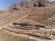 Greek studio Sinas Architects has built a house on the island of Serifos, taking cues from local dry stone walls to make the building as inconspicuous as possible.