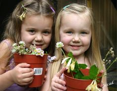 Smile - This photo always makes me smile! My granddaughters were so proud of planting their first plants... dead weeds from my gravel driveway ;)