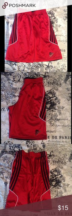 Reversible Adidas Boy's Shorts Boy's size large. First side is red with black and white detailing. Reverse side is solid black. In excellent condition! adidas Bottoms Shorts