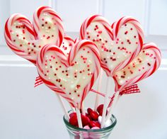 These are adorable...and such a clever use of candy canes! {Sweetheart Valentine Pops}
