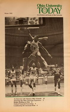 Ohio University Today, Winter 1982. Victor Alexander (54) dunks on a player from Eastern Michigan. Following the play are Bobcats John Devareaux (41) and Eric Hilton (21) :: Ohio University Archives