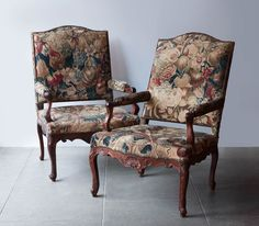 A pair of Regence armchairs covered in period tapestry early 18th century, for sale at Julia Boston Antiques, London