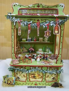Christmas stall on exhibit at the Wee C Dollhouse show in Chicago 2013.  Made from a Betterley kit.