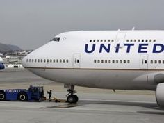 "Security officers violently drag a man from United Airlines Plane after airline reportedly overbooked flight. (And NO he did not wear ""stretchy leggings""!)  How can random passenger get beaten & thrown off ?"