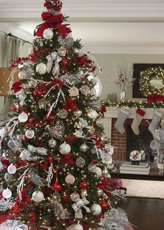 Tree toppers are a must for an elegant display. Silver Stretch Net ribbon and loops of Red Velvet Glitter ribbon add the finishing touch to this gorgeous Christmas tree.