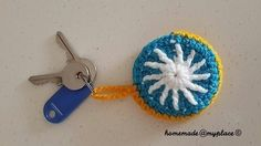 A Sunny Key Ring Cosy  •  Free tutorial with pictures on how to stitch a knit or crochet keyring in under 60 minutes