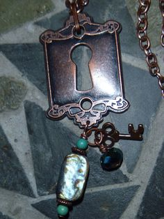 Copper plated keyhole & abalone with turquoise by DarlenePayton