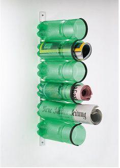 Using bottles as newspaper organizer