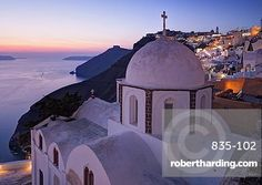 Dusk over a small church at the south of Thira in Santorini, Cyclades, Greek…