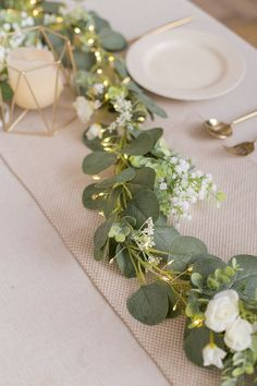 garland of flowers Flower runner:Eucalyptus runner is made with rich ranunculus asiaticus,rose,babysbreath and berry combined with a Eucalyptus garland. The battery powered led stri Greenery Garland, Light Garland, Flower Garlands, Flower Lights, Greenery Decor, Diy Garland, Eucalyptus Garland, Eucalyptus Centerpiece, Eucalyptus Wedding