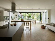 Open-plan kitchen interior design inspiration - large worktops and glass-walled living space for a modern home. Kitchen Diner Extension, Open Plan Kitchen Diner, Open Plan Kitchen Living Room, Kitchen Layout, New Kitchen, Kitchen Modern, Kitchen Extension Glazing, Modern Kitchens With Islands, Glass Extension