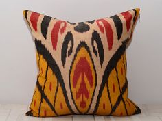 16x16 ikat pillow cover in yellow, red and black by SilkWay via Etsy
