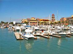 A view of Puerto Paraiso Entertainment Plaza from across the marina. Cabo San Lucas