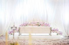 """Another sleek n simple dais with fully fresh flowers bloom in shades of pink."" by flair design."