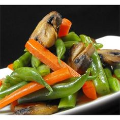 Fresh green beans and carrots are sauteed with mushrooms and onions, in a host of savory spices.