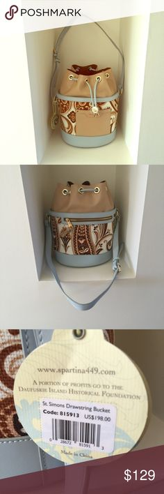 "❤️HP 10/5/16❤️  SPARTINA 449 Drawstring Bucket Bag Fabulous looking leather and fabric bucket style bag by Spartina 449.  Bag measures 12"" high and 11"" wide.  Strap is about 18"" long when fully extended.  Bottom of bag has 4 gold feet.  Front of bag has outside pocket and back has zipper pocket.  Another zipper pocket on back inside along with two small pouches on inside front.  Lined with same fabric on inside.  No PP or trades.  Smoke and pet free home.  Price is FIRM . Spartina Bags…"
