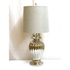 @Overstock.com - Ceramic Silver Ribbed Ginger Jar Table Lamp - Beautiful ribbing on the ceramic base of this table lamp complements the silvertone glossy finish to create a unique and sophisticated look. This table lamp is finished with a linen drum shade.  http://www.overstock.com/Home-Garden/Ceramic-Silver-Ribbed-Ginger-Jar-Table-Lamp/7396629/product.html?CID=214117 $116.09