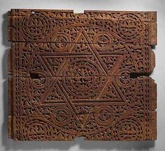 An early century Abbasid wood panel beautifully decorated with a Seal of Solomon and other carvings. Probably from Baghdad, this panel functioned as a talisman, as was common on architectural surfaces in Muslim art. Currently at the MET Museum - New York. Islamic World, Islamic Art, Seal Of Solomon, King Solomon, Roman Art, Animal Fashion, Ancient Art, Metropolitan Museum, Charms