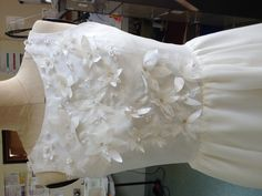 A2 level dress with beaded bodice, stitched with conductive thread and LED hidden I. The beaded flowers. Chloe S.