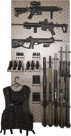 "This rack system uses three of the 24"" x 36"" wall panels and will hold 7 rifles horizontally, 5 rifles vertically, 6 hand guns, approx 8 hand gun mags, approx 8 AR (223) or AK mags and has one accessory hook. Product 1031 gsssaferoom.com"