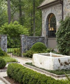 Howard Design Studio, led by creative director John Howard, designs outdoor living spaces that are rich in detail, classic in form and opulently individual. The residential gardens by the firm are noted for their geometry, balance and refinement. Dering Hall Design Connect. In partnership with Elle Decor, House Beautiful and Veranda #landscapedesignforbackyard House Beautiful, Beautiful Homes, Hall Design, Rock Wall, Water Trough, Creative Director, Spring Garden, Interior And Exterior, Water Features