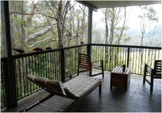 Treefern Retreat, Springbrook, Gold Coast hinterland, Australia The deck with rainforest and mountain views, and rosellas and king parrots.