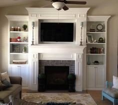stone fireplace with mounted tv and bookshelves on each side - Google Search