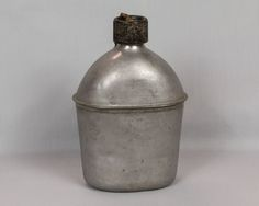 Authentic WW 2 metal canteen with cap and cork, World War 2 canteen, chain Bottom says U.S., G.P.&F.CO, 1944 by eyespytreasure on Etsy