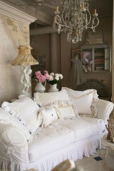 Shabby chic couch and chandelier... gorgeous!