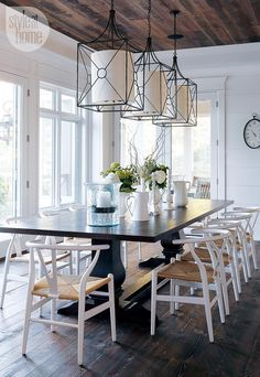 Cottage dining room boasts a glossy white coffered ceiling