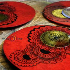 This set of 4 coasters is made out of processed paper and the coasters have been hand painted taking inspiration from Indian henna/mehndi motifs. These coasters can add vibrancy to any table top :) A water proof coating has been added to make the coasters reusable for you :) A rubber base has been provided for better grip to the table. Overall Dimensions: 12 cm diameter