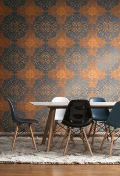Trendy blue and burnt orange lace medallion wallpaper from Wallquest's Nova Collection