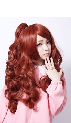 Warm copper red colour wig, full bouncy curls and a layered fringe. It comes with detachable ponytails that can be worn optional as one or a pair.  The wig comes with a hair net and is fully lined with adjustable strap for added comfort whilst wearing. The tails are fitted with large tooth hairgrips and have their own nets. Wig is not shiney.