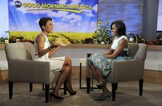 """Mrs. O talks to Robin Roberts live in Times Square to discuss her new book, """"American Grown,"""" on Good Morning America, May 29, 2012 in New York. The First Lady dressed casual in a turquoise dress accented with a brown belt and matching kitten heels."""