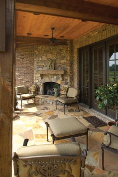 fireplace that is inside and outside on the veranda of my dream house