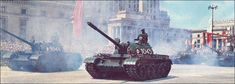 Polish Army T-55 main battle tanks rolling through parade square in Warsaw at the 1966 Polish Liberation Day and Millennial Anniversary Parade.