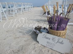 dress up your guests! parasols for beach ceremony