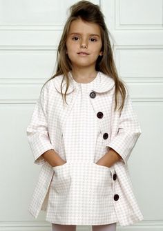 french blossom - this little girl is so incredibly classy and I don't even consider classy a word to be applied to a child!!! I wonder what Country she is from. The coat & dress are really beautiful.