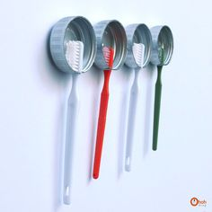 Make fast toothbrush holders from bottle caps Turn large bottle caps into minimalist toothbrush holders and stick them up with velcro