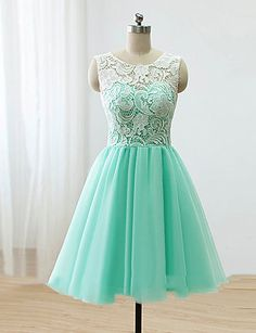 Knee-length lace and tulle bridesmaid dress. This pretty dress is a sweet and comfortable look. Choose from nine colors.