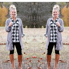 Cute black and white plaid top.  Tab button sleeves and button front. 100% Polyester