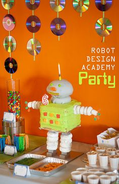 Robot Birthday Party - like the use of CD/DVD decorations