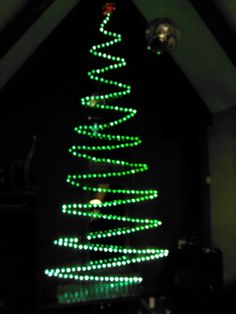 I made this Christmas tree out of one strand of lights attached to ...