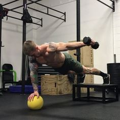 . Movement of the Day • Medicine ball single arm plank to lateral raise to front raise. This movement is a beast! So many benefits to this one. Just the unilateral shoulder stabilization in itself is awesome and will do great things for your shoulder health. This also works anti rotational core strength and stability and as well as some shoulder strength work with the lateral raise to front raise. The time under tension here is pretty nasty. Stay focused and keep those hips and parallel w...