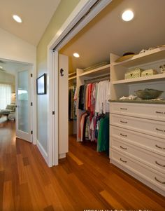 Different take on a walk-in closet. It's long and narrow which allows for long closet rods to hang clothes