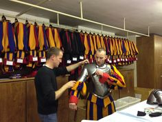 A Swiss Guard being fitted for uniform in the Vatican