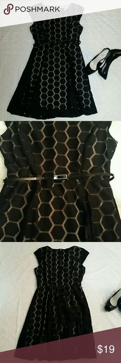 Elegant A line dress Size medium. Black with tan color. 92% polyester  and 8%spandex. Used once. Comes with thin belt as shown in pic. Dresses